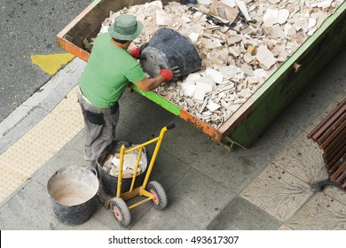 bricklayer mason depositing waste