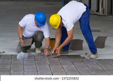 bricklayer at work in building site