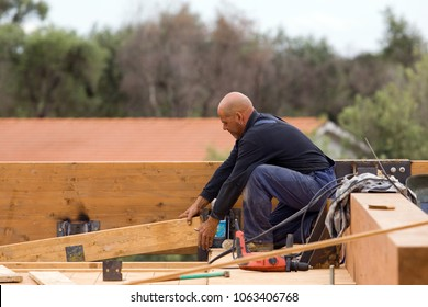 bricklayers at work in a building site