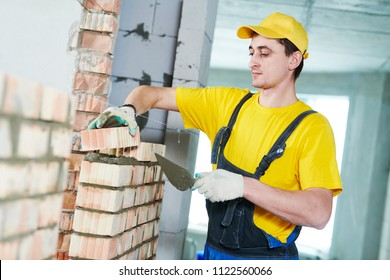 bricklaying. Construction worker building a brick wall