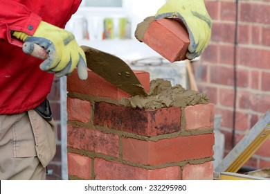 Bricklaying - laying brick to make a gate post