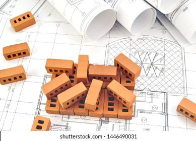 Bricks for building a house with design drawings