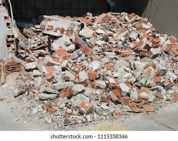 bricks and debris of a damage house