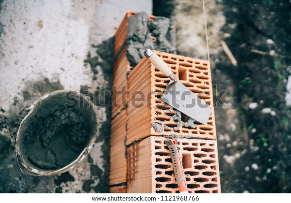 bricks details, construction site tools and bricklayer construction site