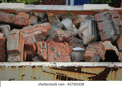 Bricks in a dumpster near a construction site, home renovation
