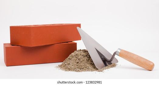 bricks and mason tools isolated on white