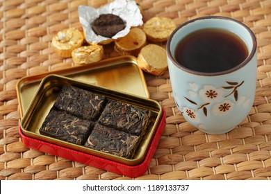 Bricks of Pu-erh tea and gaiwan closeup