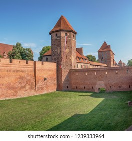 Bricks wall and tower in sunny day, Malbork, Poland