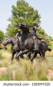 BRICKTOWN OKLAHOMA CITY - AUGUST 4 2018. Bronze statues that are part of the Centennial Land Run Monument in Bricktown, Oklahoma, USA.