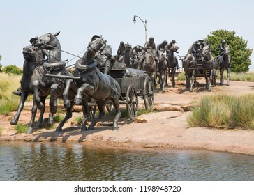 BRICKTOWN OKLAHOMA CITY - AUGUST 4 2018. Bronze statues that are part of the Centennial Land Run Monument in Bricktown, Oklahoma, USA.