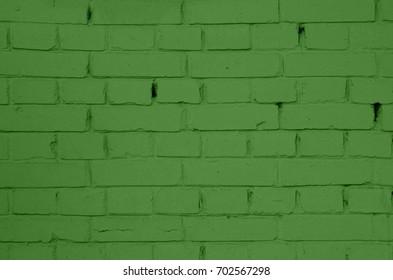 Brickwall of green brick. Brick masonry with rough seams. Green brickwork. Brick masonry with smooth seams. Green brick-wall texture. Building of green brick. Brick-wall texture background.
