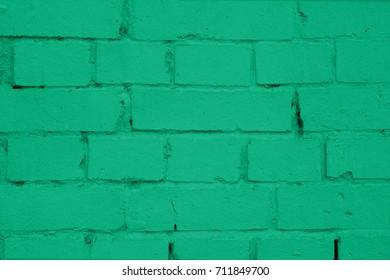 Brick-wall of mint green painted brick. Green painted brick wall texture. Brick-wall of mint green brick. Painted brickwork. Brick masonry. Mint green brick-wall texture. Building of mint-green bricks