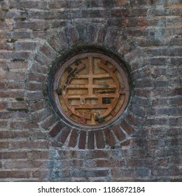 Brickwork detail at The Historic Buddhist Temple Pagoda of the Celestial Lady or Thien Mu Pagoda, Hue, Vietnam.