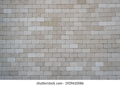 Brickwork of gray, large bricks, outside. Brick wall texture background, copy space