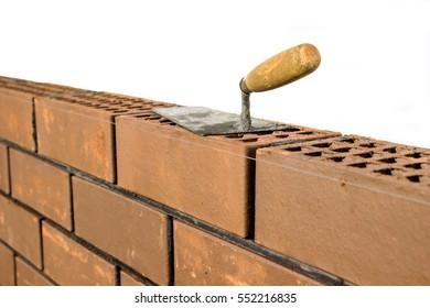 The brickwork  is trowel, bricklayer tool. construction work