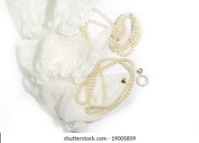 Bridal accessories - stockings, pearls, ring and earrings over white background