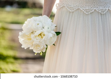 Bridal bouquet. Bride holding bunch of peony flowers. Beautiful white Peony.