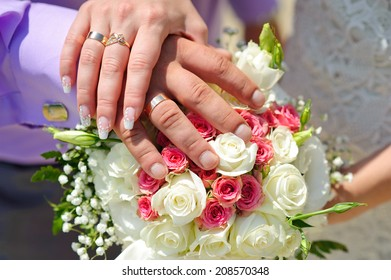 bridal bouquet. brides and grooms hands. wedding