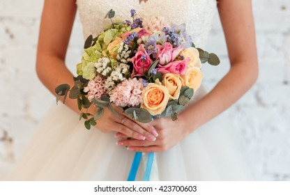 Bridal bouquet of flowers in a bride's hands