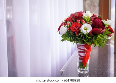 Bridal bouquet, fresh flowers of red color