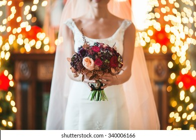 Bridal bouquet in hands, wedding in Christmas