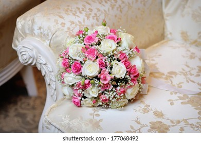 bridal bouquet lying on the sofa