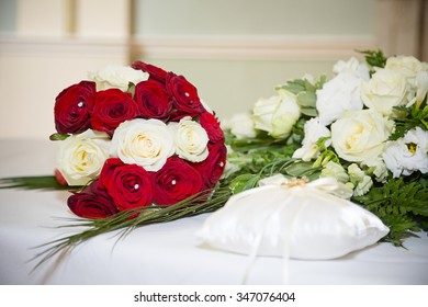 bridal bouquet next to roses