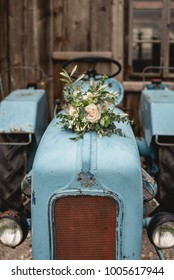 Bridal bouquet on a light blue tractor
