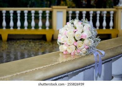 Bridal Bouquet on Marble Railing Balustrade