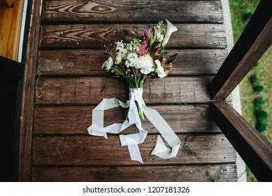 Bridal bouquet on wooden floor