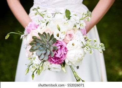 bridal bouquet with peonies and succulents