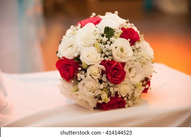 Bridal bouquet with red white white roses
