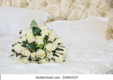 Bridal bouquet of roses hand-made on the bed
