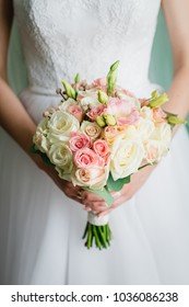 a bridal bouquet of roses in hands. wedding dress wedding ring