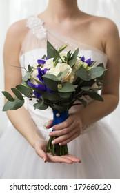 bridal bouquet of roses of irises