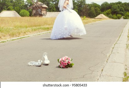 bridal bouquet and shoes in the park and run away bride