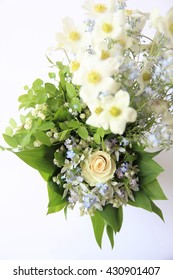 Bridal bouquet of white rose in bright colors