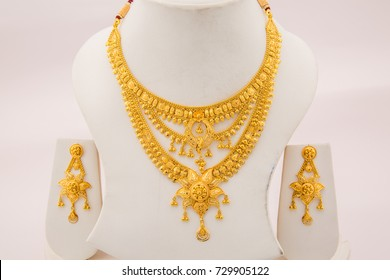 Bridal collection three layer beads intricate finish gold necklace with chandelier earrings