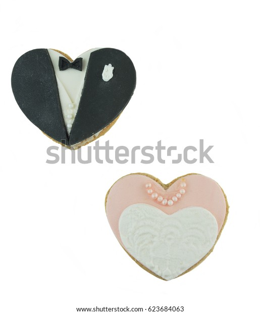 Bridal cookies of heart shaped dress and tux  isolated on white background