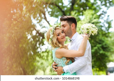 Bridal couple celebrating engagement in the park