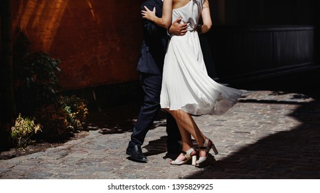 Bridal couple is happy dancing together, just married groom and bride.