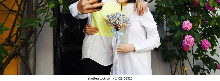 Bridal couple having fun in a city, happy bride and groom together.