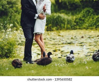 Bridal couple having their marriage ceremony in the botanical garden.