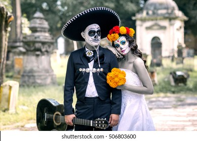 Bridal couple with makeup and costumes typical Mexican in a cementery.