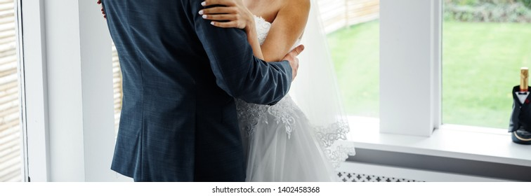 Bridal couple is ready for getting married, happy bride and groom at home.