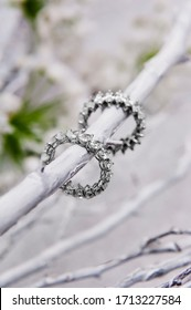 bridal diamond ring with white floral background arrangement