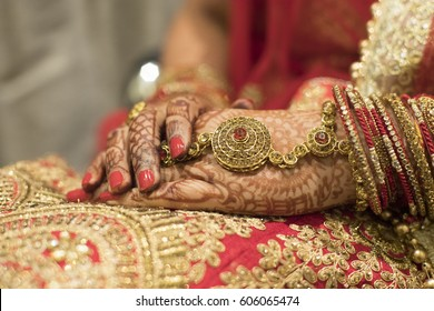 Bridal dress and hand of bride, Indian Wedding Preparation. Luxury Oriental Fashion beauty Accessories: Female Hands, Beautiful National Indian Bridal Golden Jewellery.