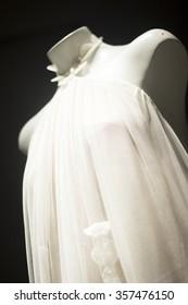 Bridal dress store bride wearing modern stylish wedding gown photo.