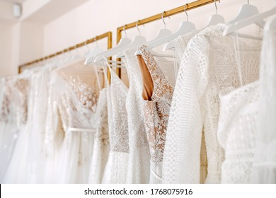 Bridal dresses collection at showroom. Luxury bridal gowns shop.