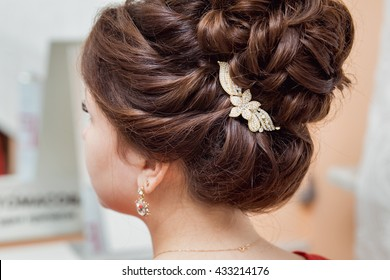 Bridal hairstyle with vintage style hair accessories.